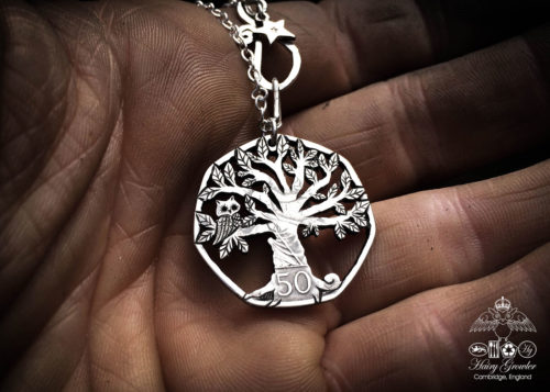 Handmade and upcycled coin owl in the tree pendant necklace