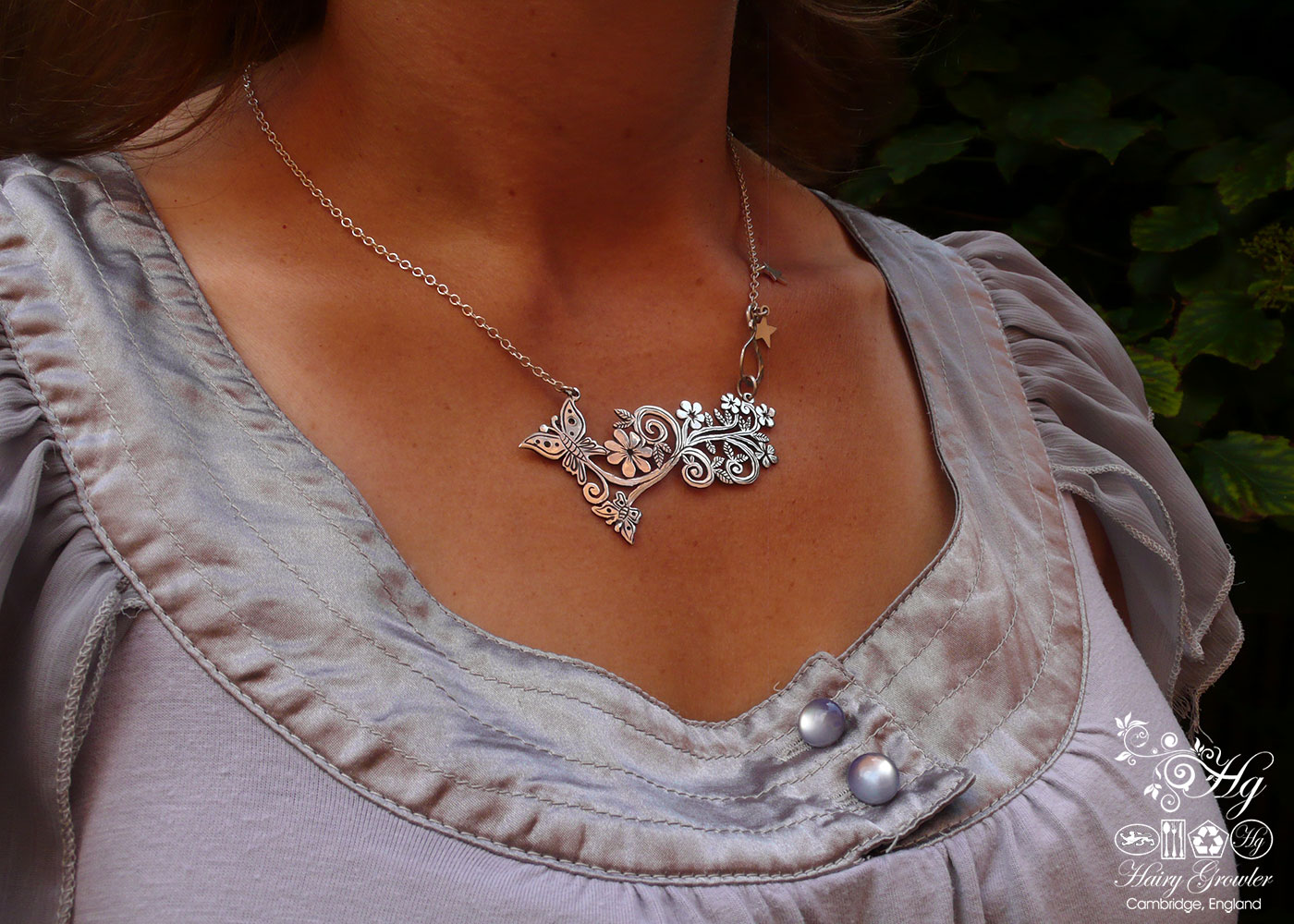 Handcrafted and recycled sterling silver crown coin butterfly necklace