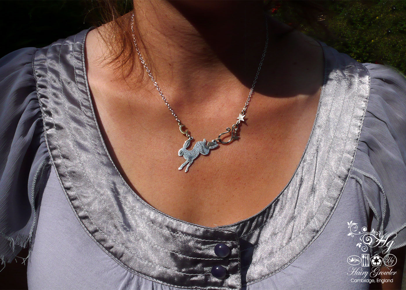 Handmade and upcycled sterling silver moon leaping hare necklace