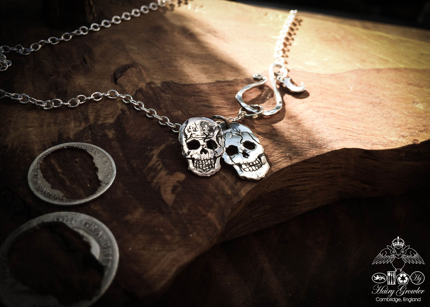 Handmade and upcycled silver sixpence coin skull necklace