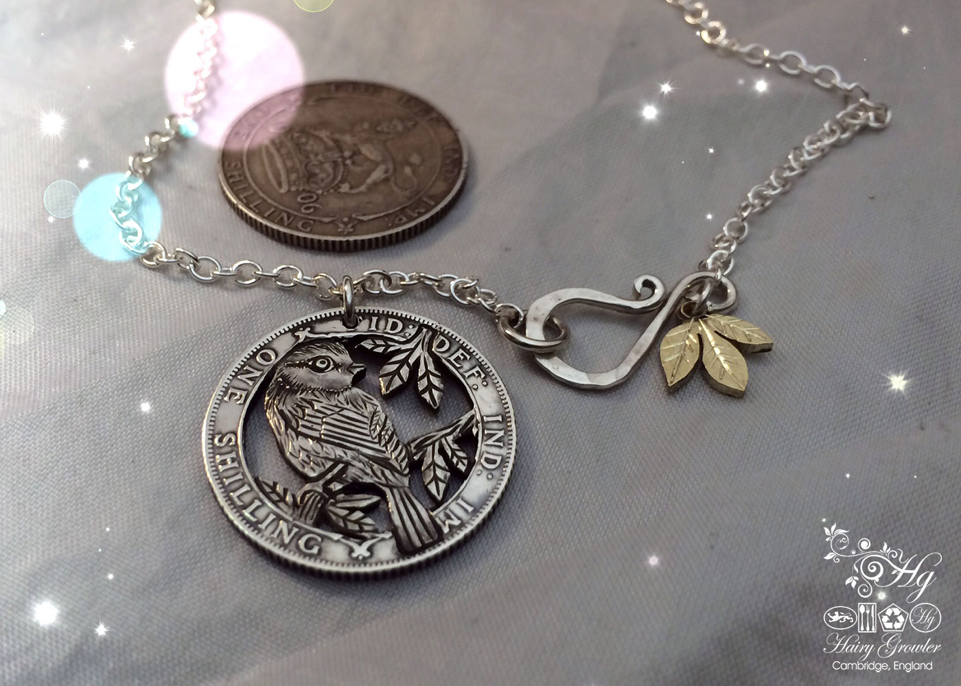 Hand made and repurposed silver shilling The Silver Shilling collection. silver blue-tit necklace totally handcrafted and recycled from old sterling silver shilling coins. Designed and created by Hairy Growler Jewellery, Cambridge, UK. necklace