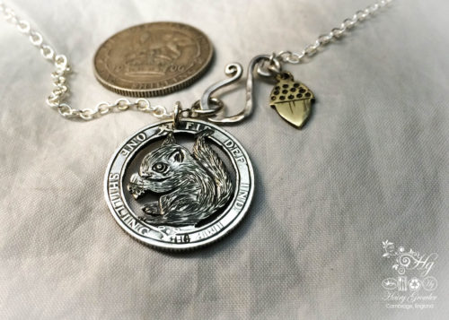 Handmade and repurposed silver shilling The Silver Shilling collection. silver squirrel necklace totally handcrafted and recycled from old sterling silver shilling coins. Designed and created by Hairy Growler Jewellery, Cambridge, UK. necklace