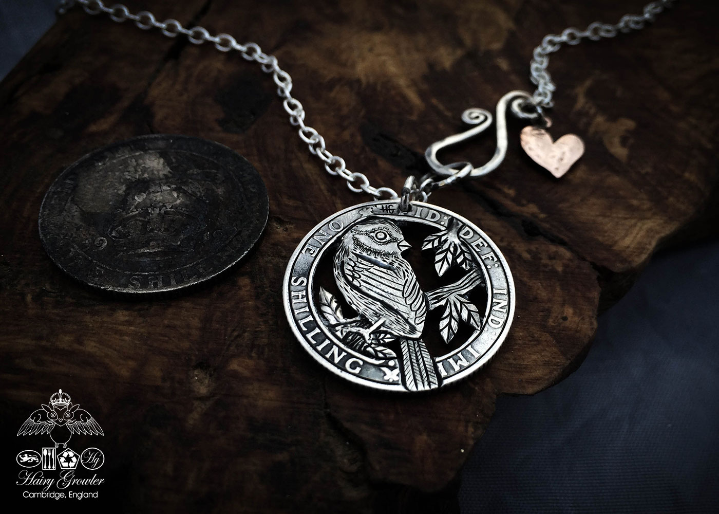Handcrafted and repurposed silver shilling The Silver Shilling collection. silver blue-tit necklace totally handcrafted and recycled from old sterling silver shilling coins. Designed and created by Hairy Growler Jewellery, Cambridge, UK. necklace
