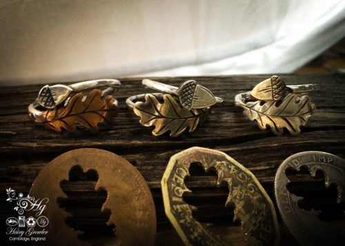 handcrafted and recycled silver shilling oak leaf and acorn rings