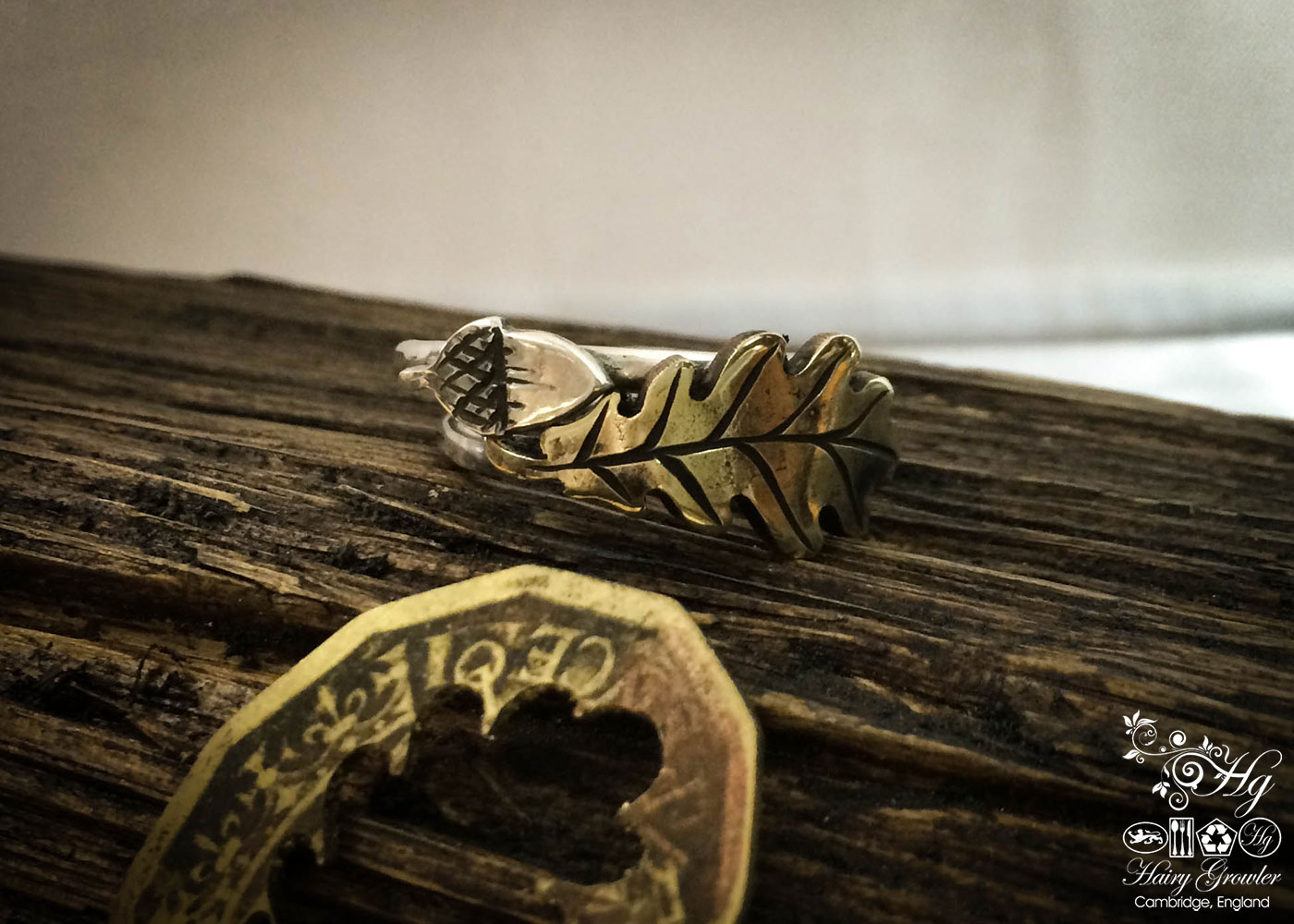 handcrafted and recycled bronze acorn and silver stacking rings