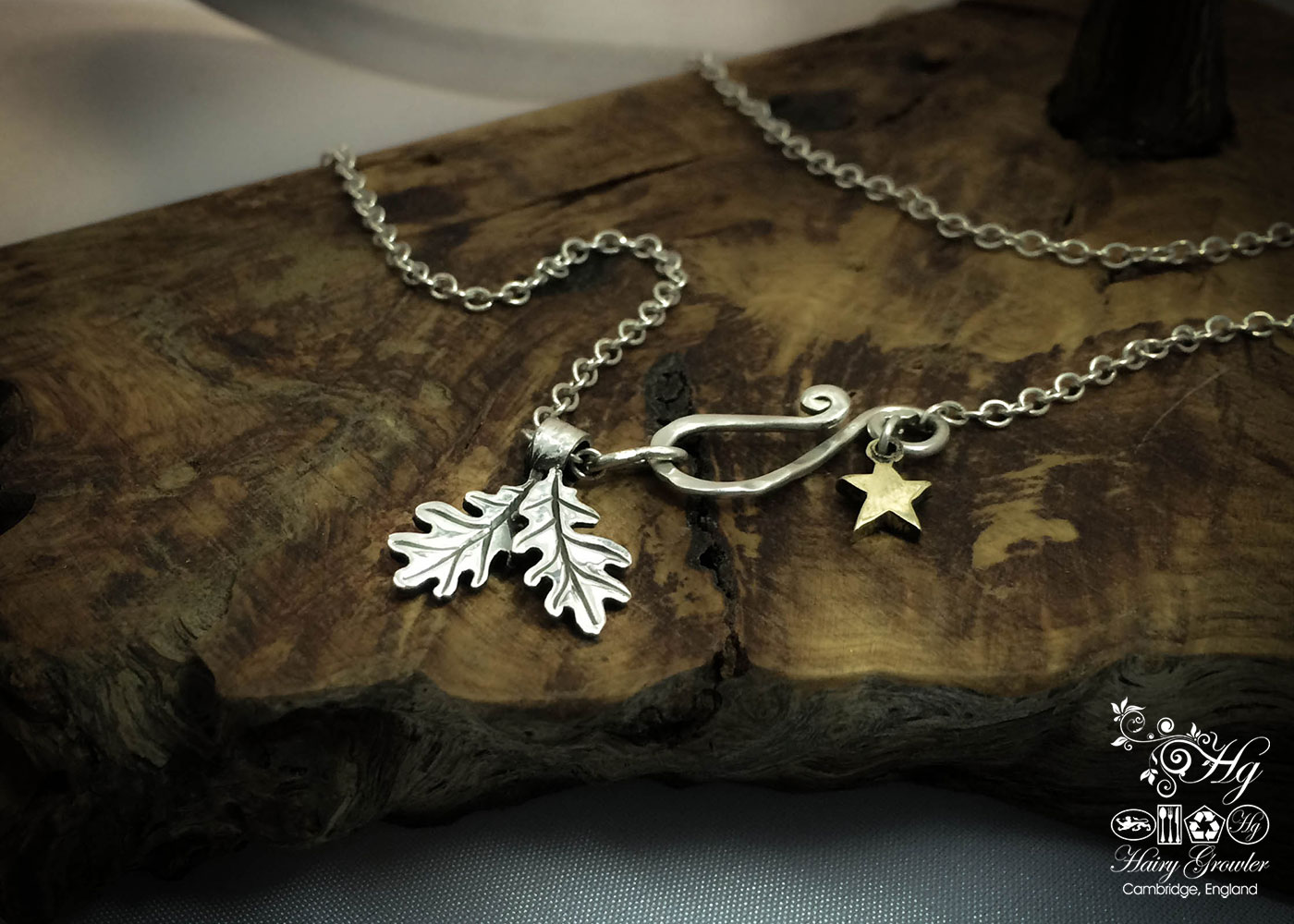 handcrafted silver pair of oak leaves charm for a tree sculpture, necklace or bracelet