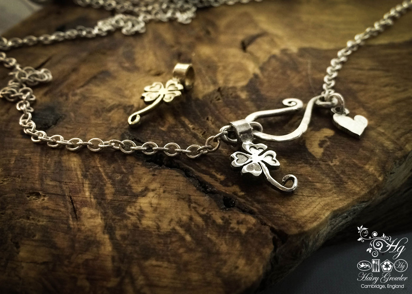 handcrafted and recycled silver lucky four leaf clover charms for a tree sculpture, necklace or bracelet