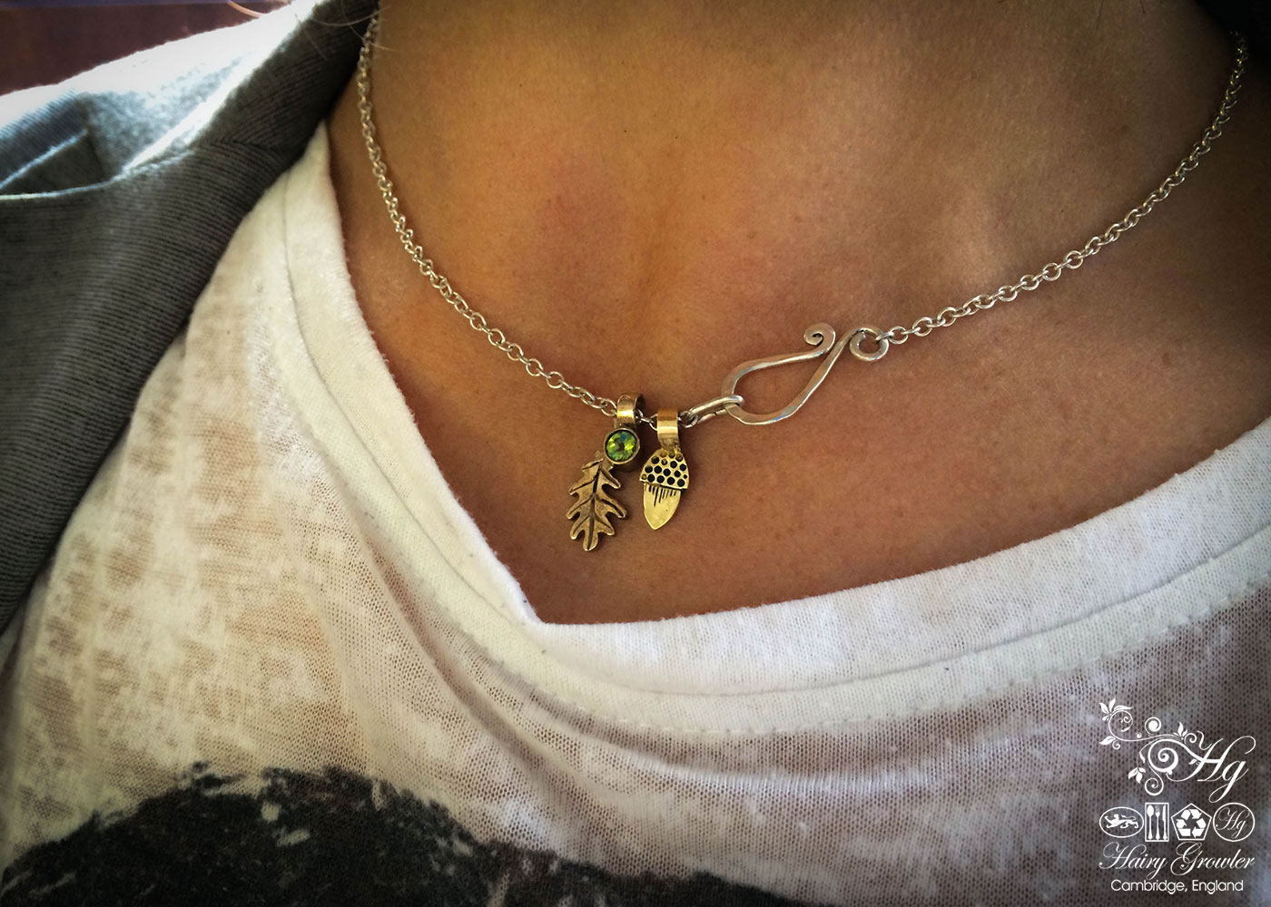 handcrafted bronze and peridot and garnet oak leaf charm for a tree sculpture, necklace or bracelet