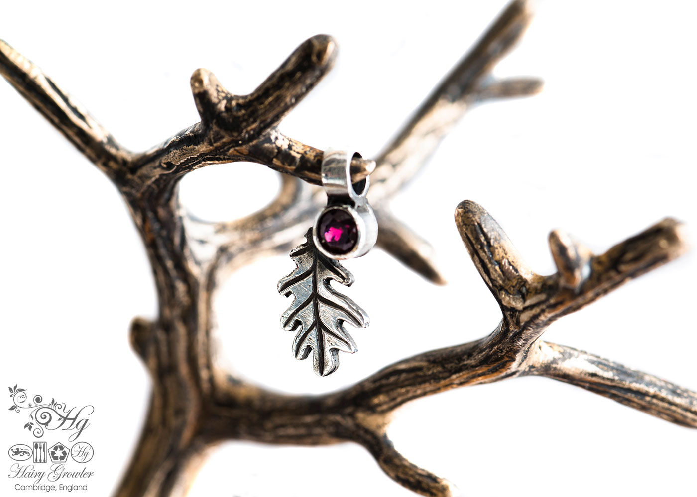 handcrafted silver and garnet oak leaf charm for a tree sculpture, necklace or bracelet