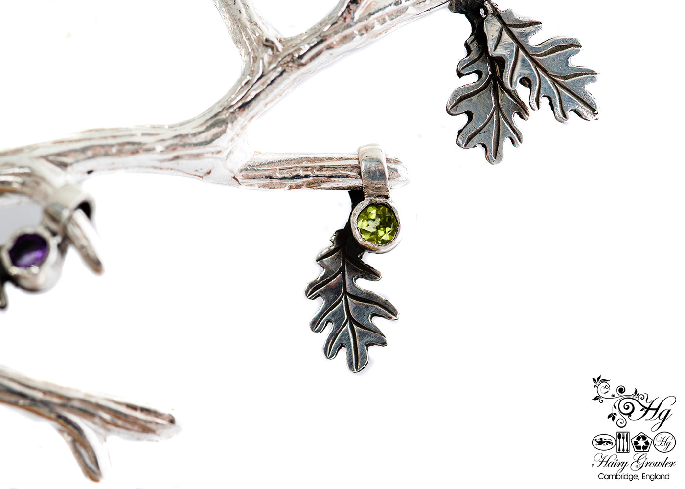 handcrafted silver and peridot oak leaf charm for a tree sculpture, necklace or bracelet