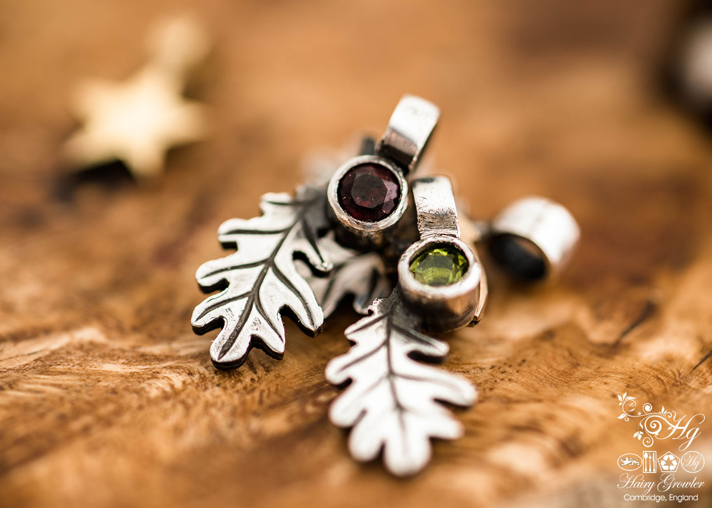 handcrafted silver and peridot and garnet oak leaf charm for a tree sculpture, necklace or bracelet