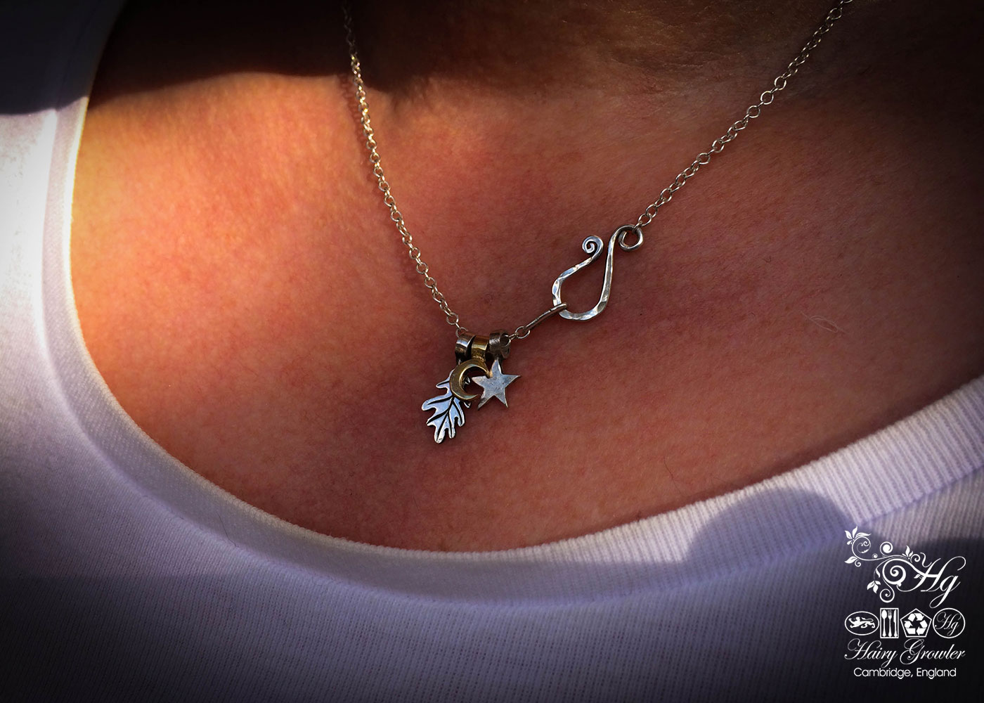 handmade recycled upcycled silver star and moon charm for a tree sculpture, necklace or bracelet