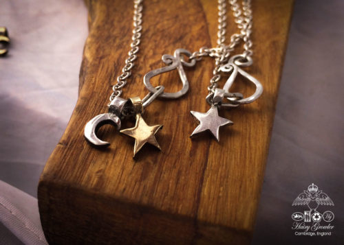 handcrafted and recycled silver star and moon charm for a tree sculpture, necklace or bracelet