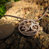 Handcrafted and recycled coin fixed speed bicycle pendant necklace.