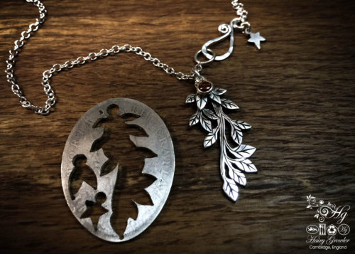 handcrafted and upcycled silver coin leafy branch necklace pendant