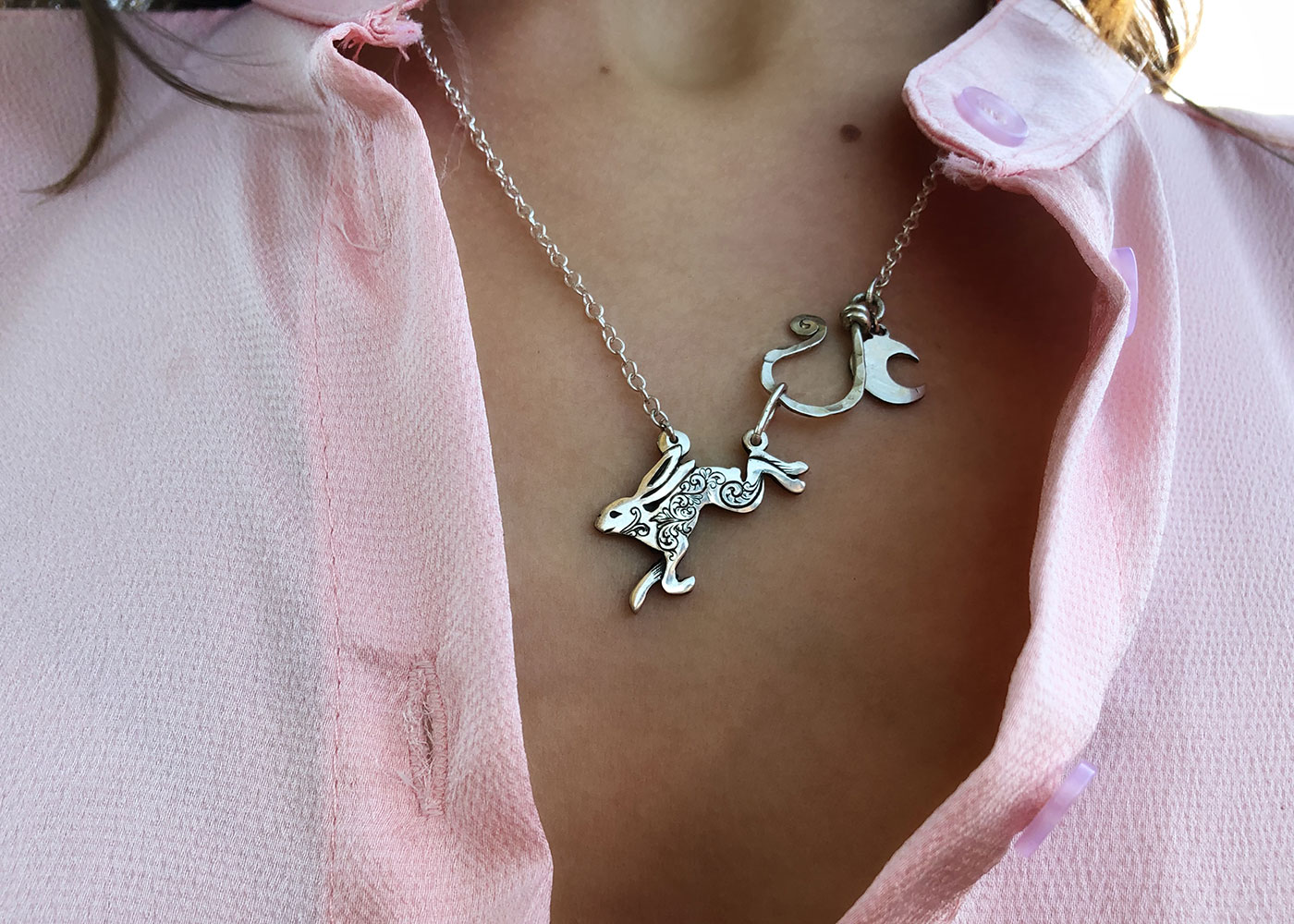 Leaping hare necklace handmade and recycled silver coin jewellery ethically handcrafted at an independant artisan studio workshop
