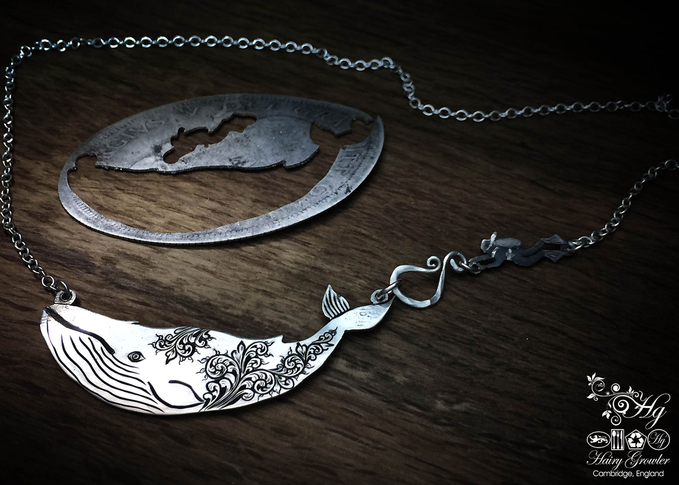 Handcrafted and recycled sterling silver half crown coin leviathan whale necklace