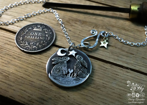 Handcrafted and recycled sterling silver shillings moon gazing hare necklace