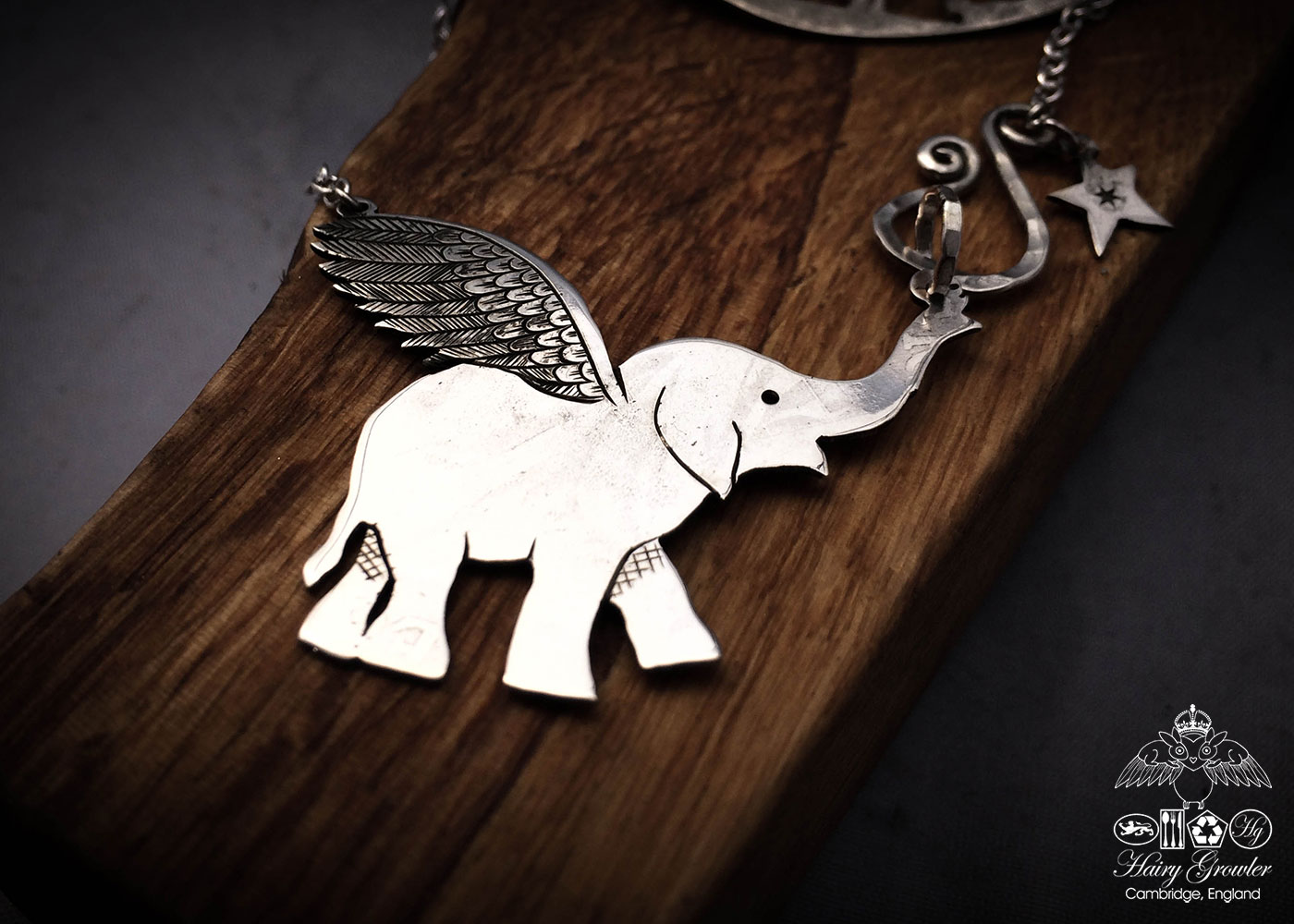 Handcrafted and recycled sterling silver flying-elephant necklace
