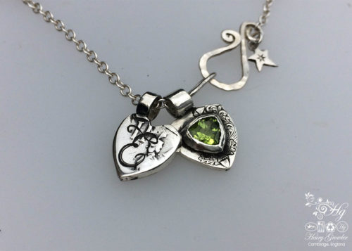 handcrafted silver and peridot family shield for a tree sculpture, necklace or bracelet