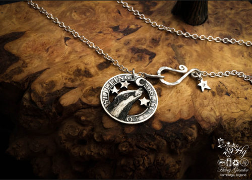 Handcrafted and recycled silver shilling The Silver Shilling collection. silver badger necklace totally handcrafted and recycled from old sterling silver shilling coins. Designed and created by Hairy Growler Jewellery, Cambridge, UK. necklace