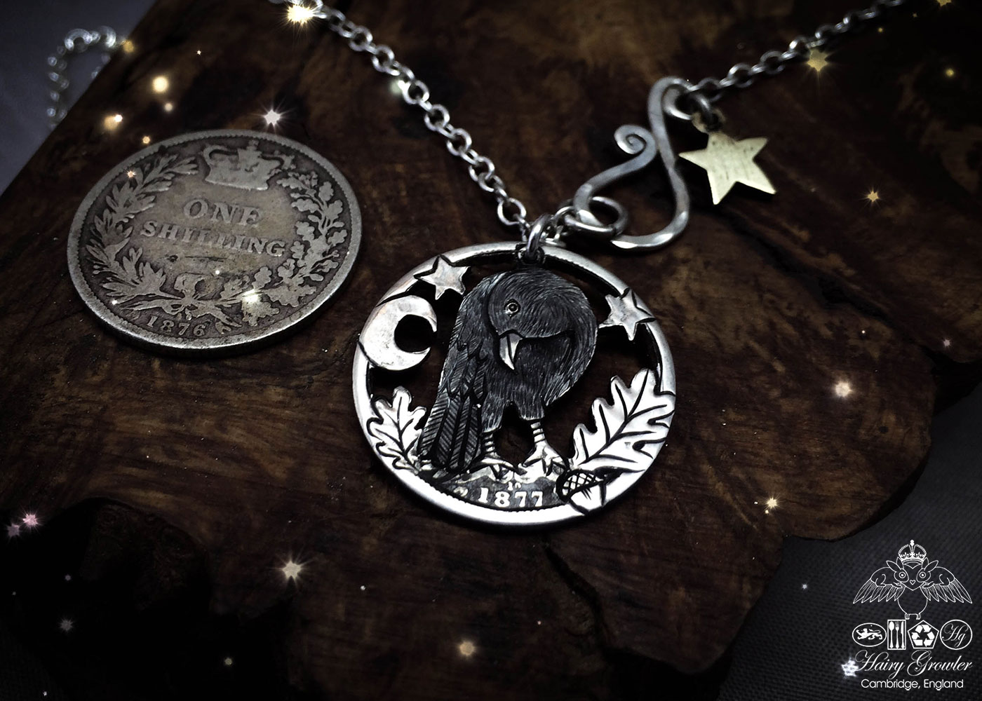 Handmade and repurposed silver shilling curious raven necklace totally handcrafted and recycled from old sterling silver shilling coins. Designed and created by Hairy Growler Jewellery, Cambridge, UK