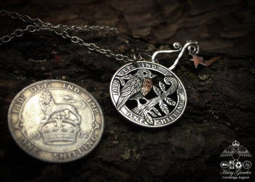 Handmade and completely upcycled and repurposed silver shilling robin red breast necklace pendant