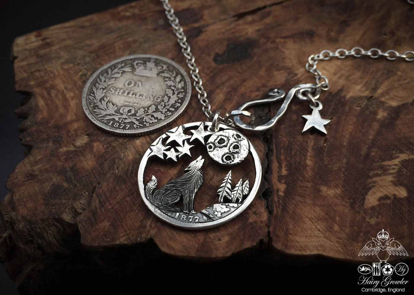 Handcrafted and recycled silver shilling The Silver Shilling collection. silver wolf necklace totally handcrafted and recycled from old sterling silver shilling coins. Designed and created by Hairy Growler Jewellery, Cambridge, UK. necklace