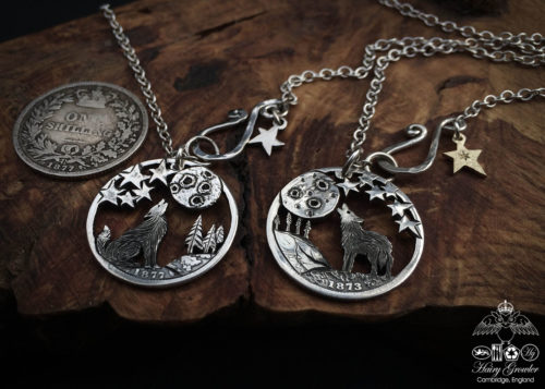 Handcrafted and recycled silver shilling The Silver Shilling collection. silver wolves necklace totally handcrafted and recycled from old sterling silver shilling coins. Designed and created by Hairy Growler Jewellery, Cambridge, UK. necklace