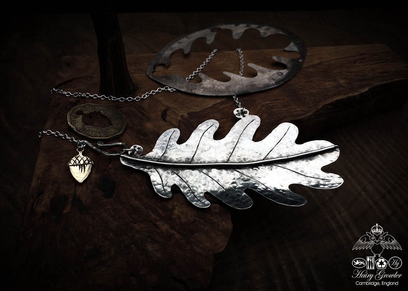 Handcrafted and recycled silver oak leaf necklace made from a silver crown coin