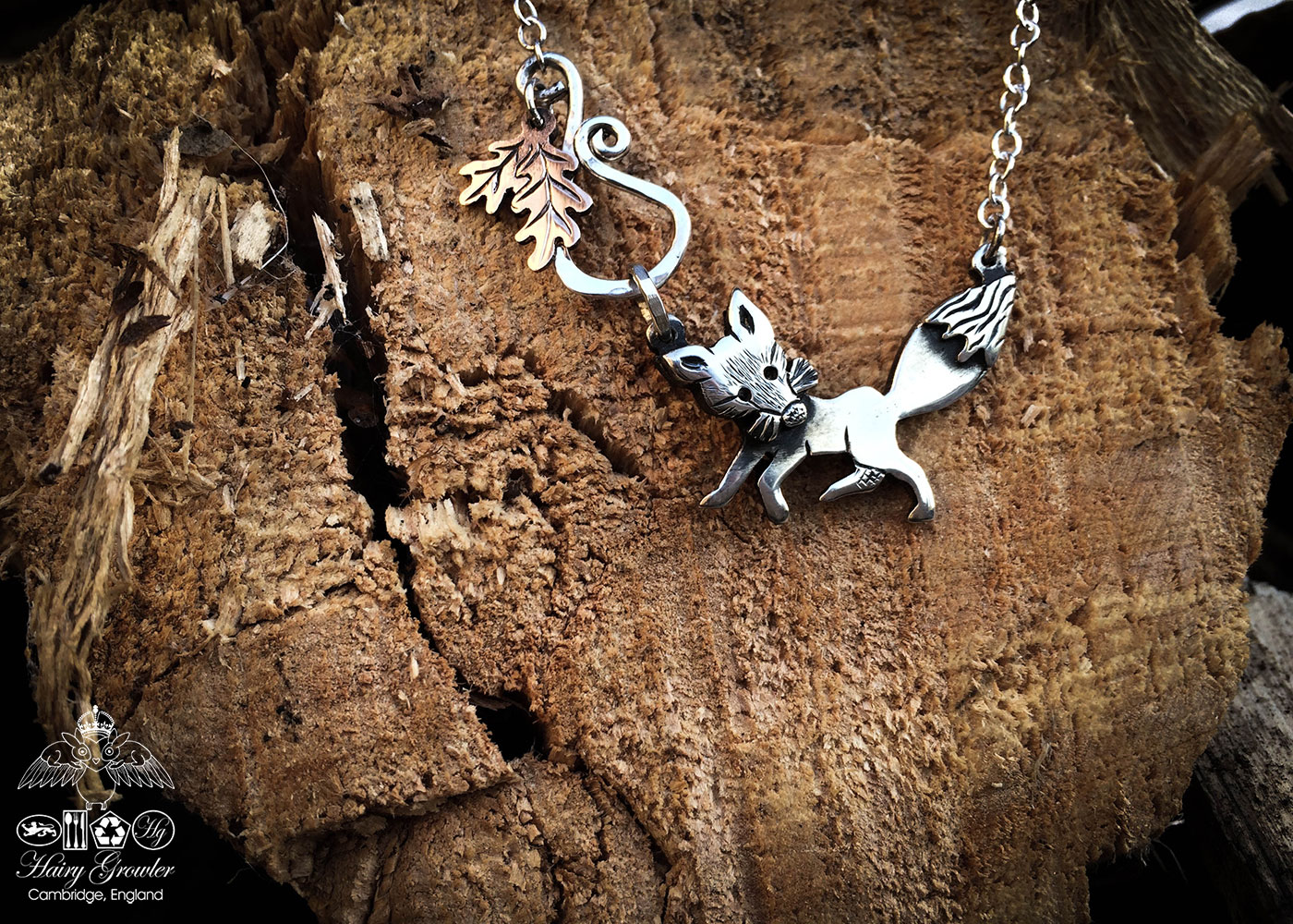 Handcrafted and recycled silver curious fox necklace made from silver coins