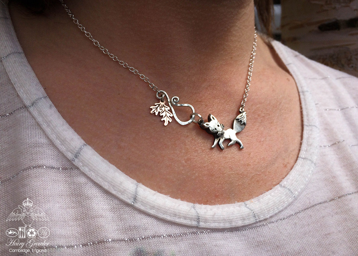 Handmade and upcycled silver curious fox necklace made from silver coins