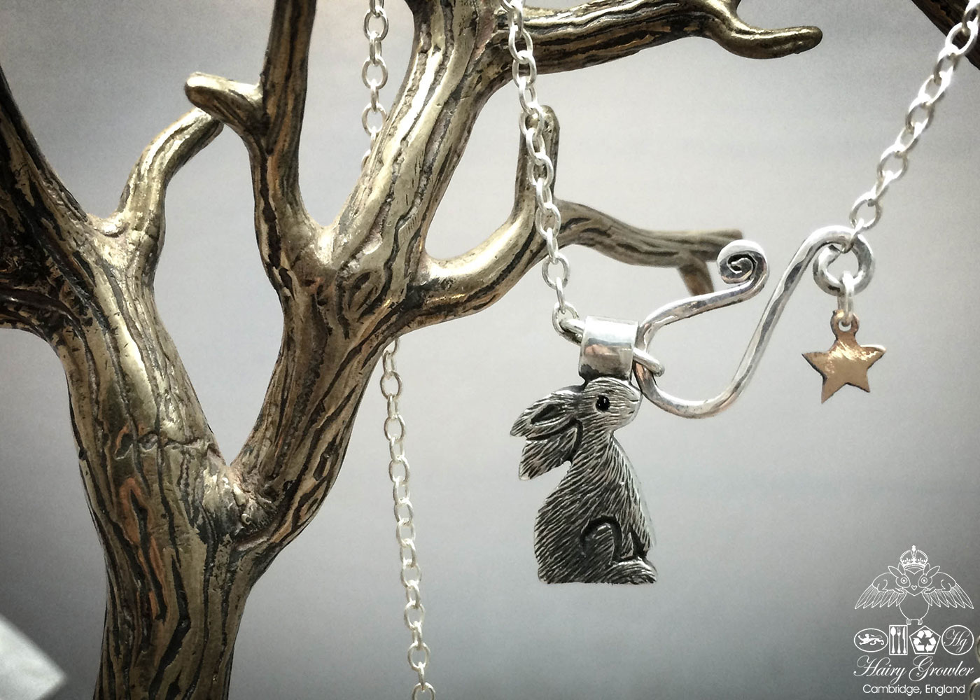 handmade and recycled silver coins moon gazing hare charm for a tree sculpture, necklace or bracelet