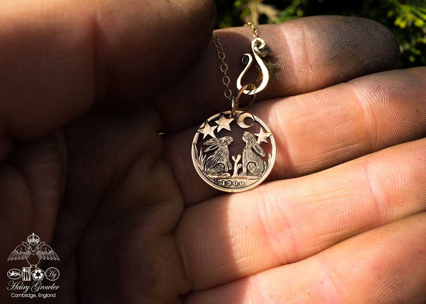 Handmade and completely upcycled and repurposed moon gazing hares necklace totally handcrafted and recycled from old 22ct solid gold sovereign coins. Designed and created by Hairy Growler Jewellery, Cambridge, UK.