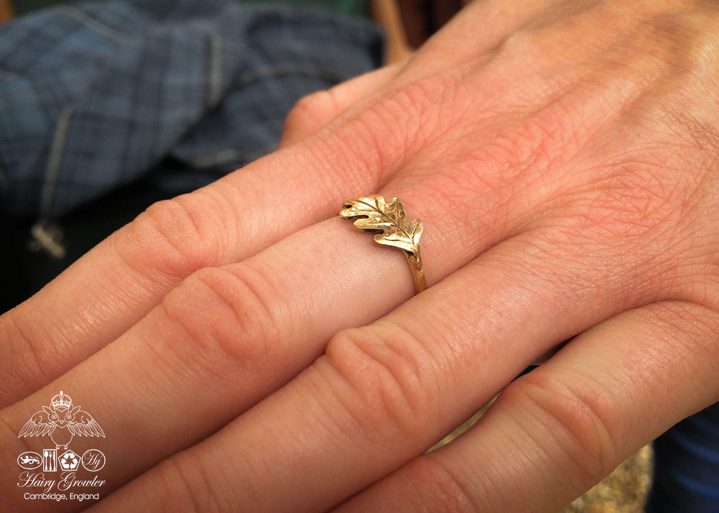 handcrafted and recycled 22ct gold sovereign oak leaf ring. Totally handcrafted and recycled. Unusual and interesting.