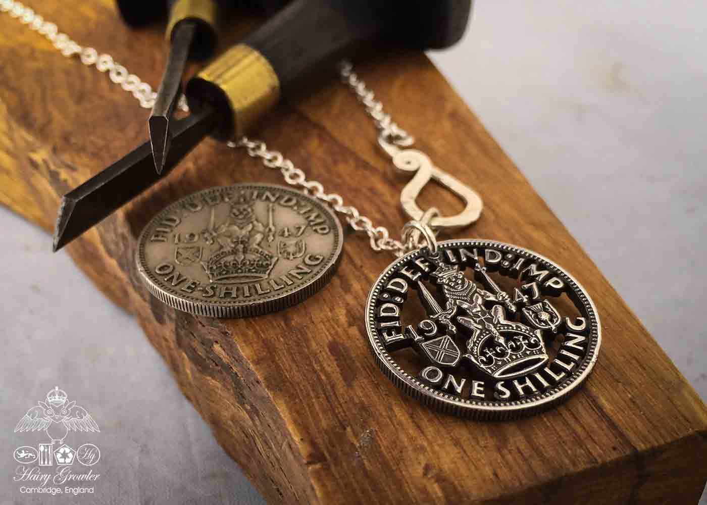 Handcrafted and recycled birthday shilling pendant