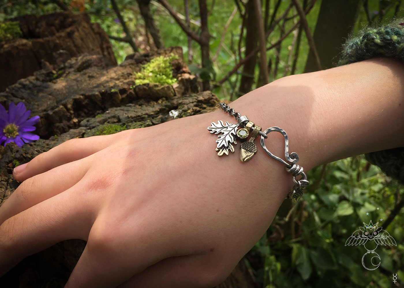 Silver charm bracelet handcrafted and recycled for the tree of life sculpture collection