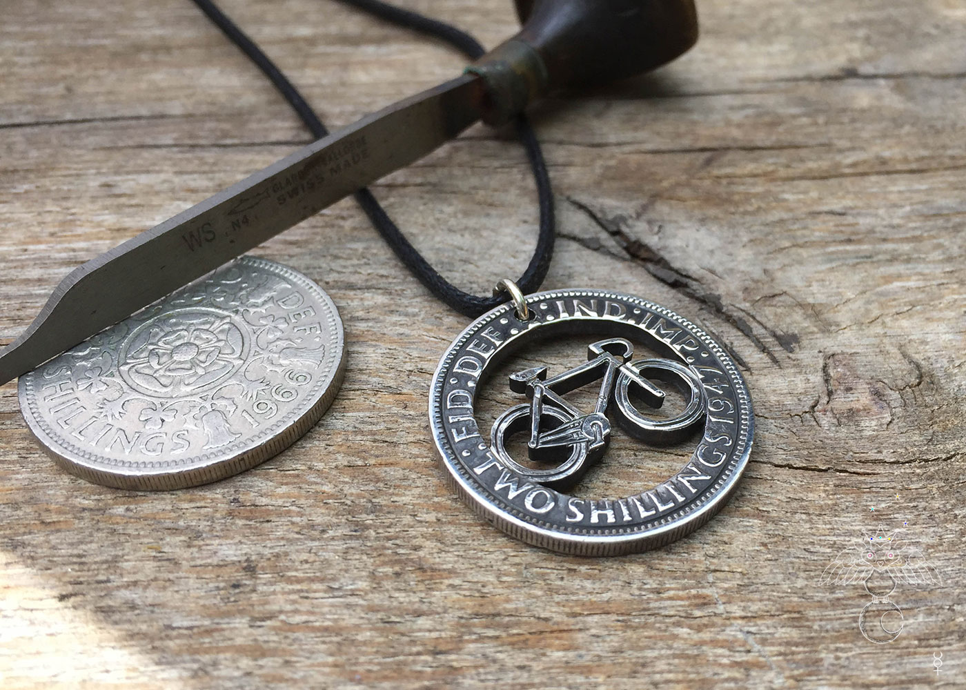 two shilling ten pence coin bicycle fixedgear cycle pendant necklace handmade and recycled in Cambridge.