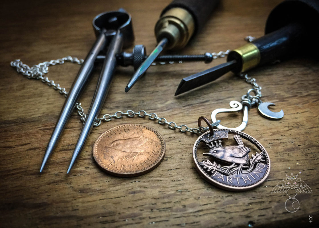 Jenny wren coin jewellery hand cut and carve by ethical jeweller Hairy Growler. Original handcrafted and recycled jewellery from an artisan studio independent workshop in Cambridge