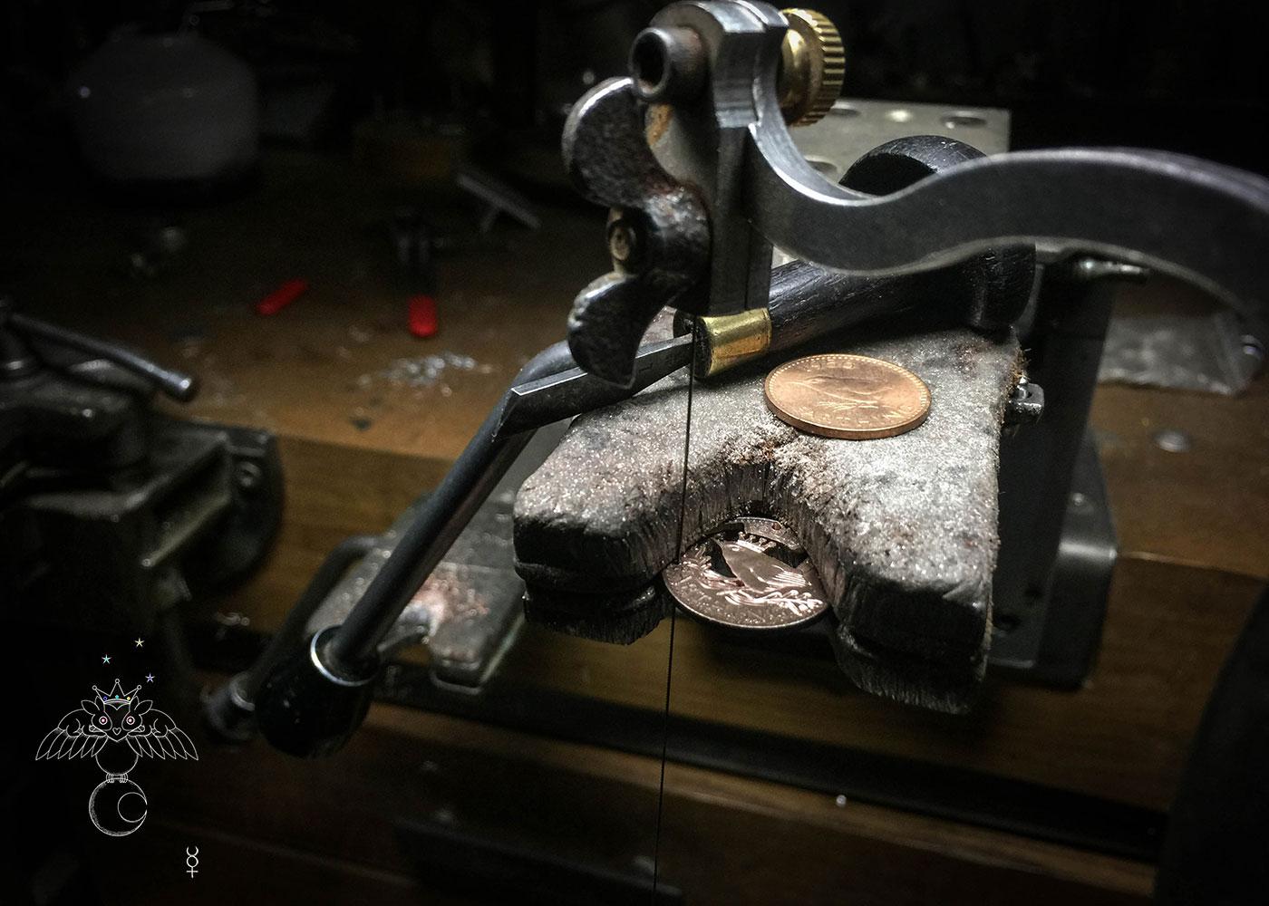 Jenny wren cut coin pendant