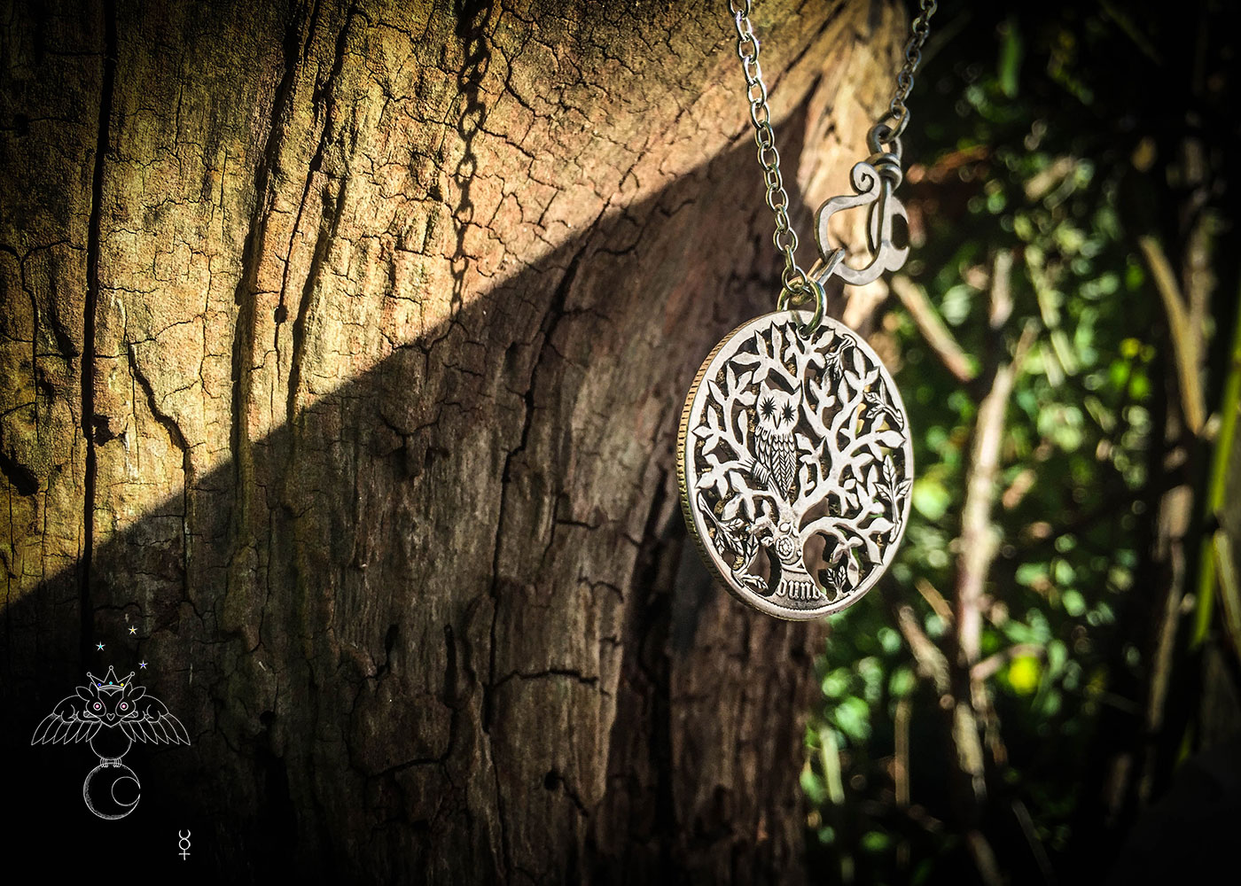 Tree of life silver coin necklace handcrafted and recycled ethical jewellery created at an artisan jewellery studio workshop in Cambridge, England. Eco-conscious, green and eco-friendly jewellery.
