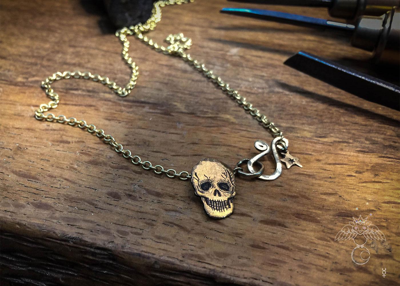 Gold memento mori necklace