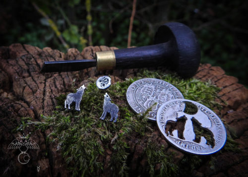 Wolf earrings - handmade and recycled sterling silver shilling coin.