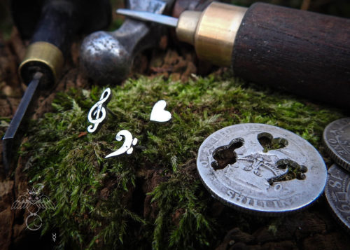 Musician earrings - handcrafted using traditional hand tools and techniques.  Handmade from recycled silver shillings.
