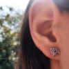 rebirth and regeneration louts flower and om earrings handmade and recycled silver coin